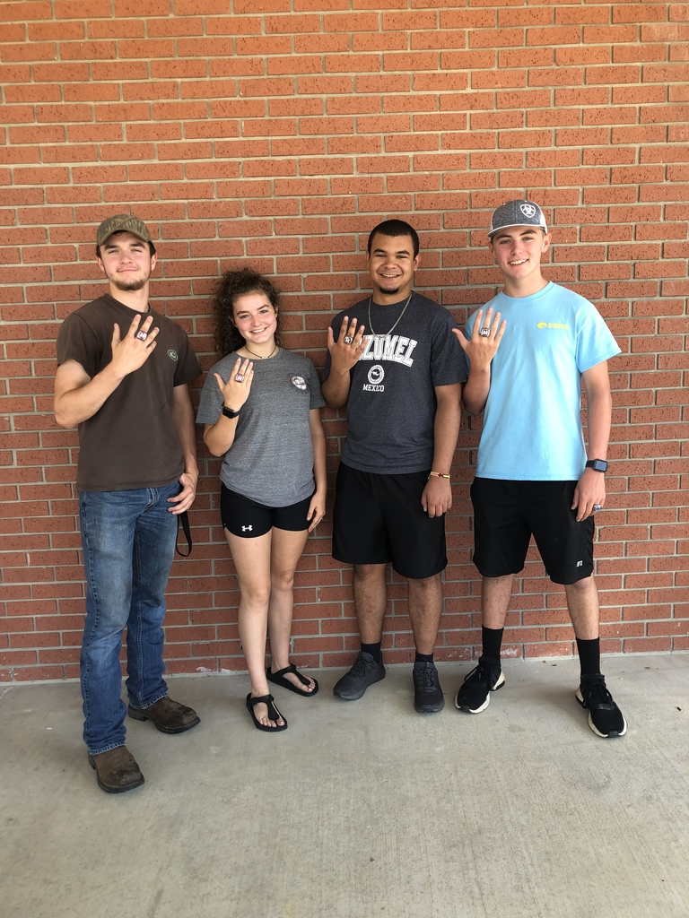 Alan, Madison, Greg, and Braden sporting their rings.