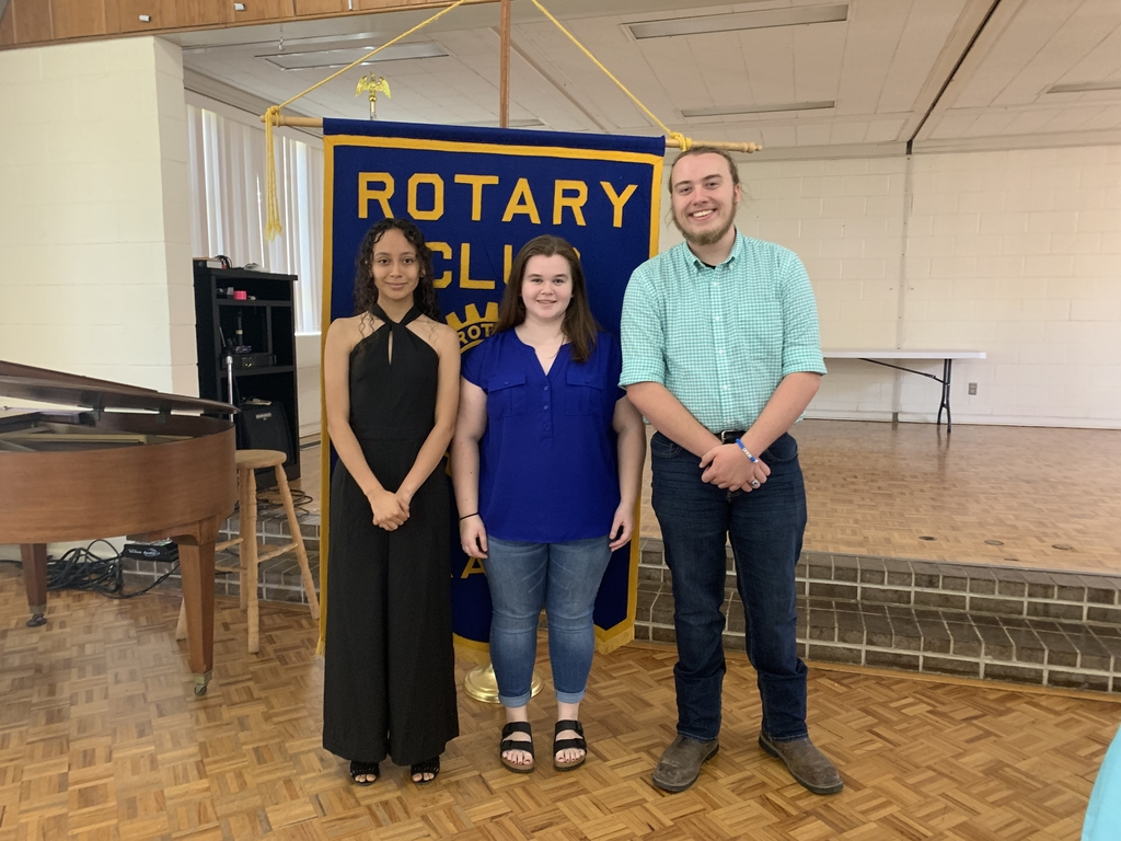 Genesis and other students at Rotary.